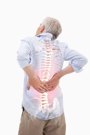 man with back pain needing ergonomic chair