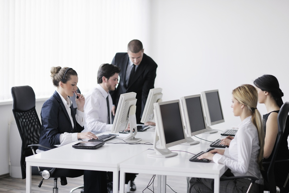 business people group with  headphones giving support in  help desk office to customers, manager giving training and education instructions-1